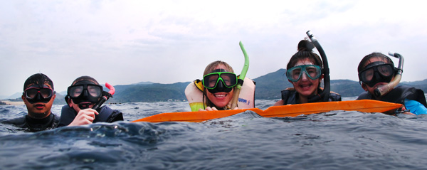 High Tech Middle Media Arts teacher Erika Reed and her students get ready to snorkel at Ready to snorkel over Hobihu reef in Taiwan.
