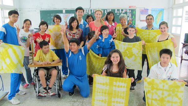 A great visit with students and teachers in a special education class at Chechung Jr. High.  Showing off our tie-dye prints that we made during our visit.