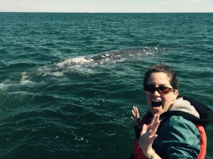 Education Specialist Lisa with a gray whale.