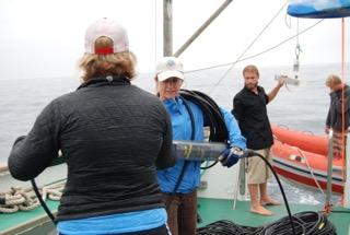 Dolphin sound scientist, Anne Simonis prepares an acoustic array for deployment.