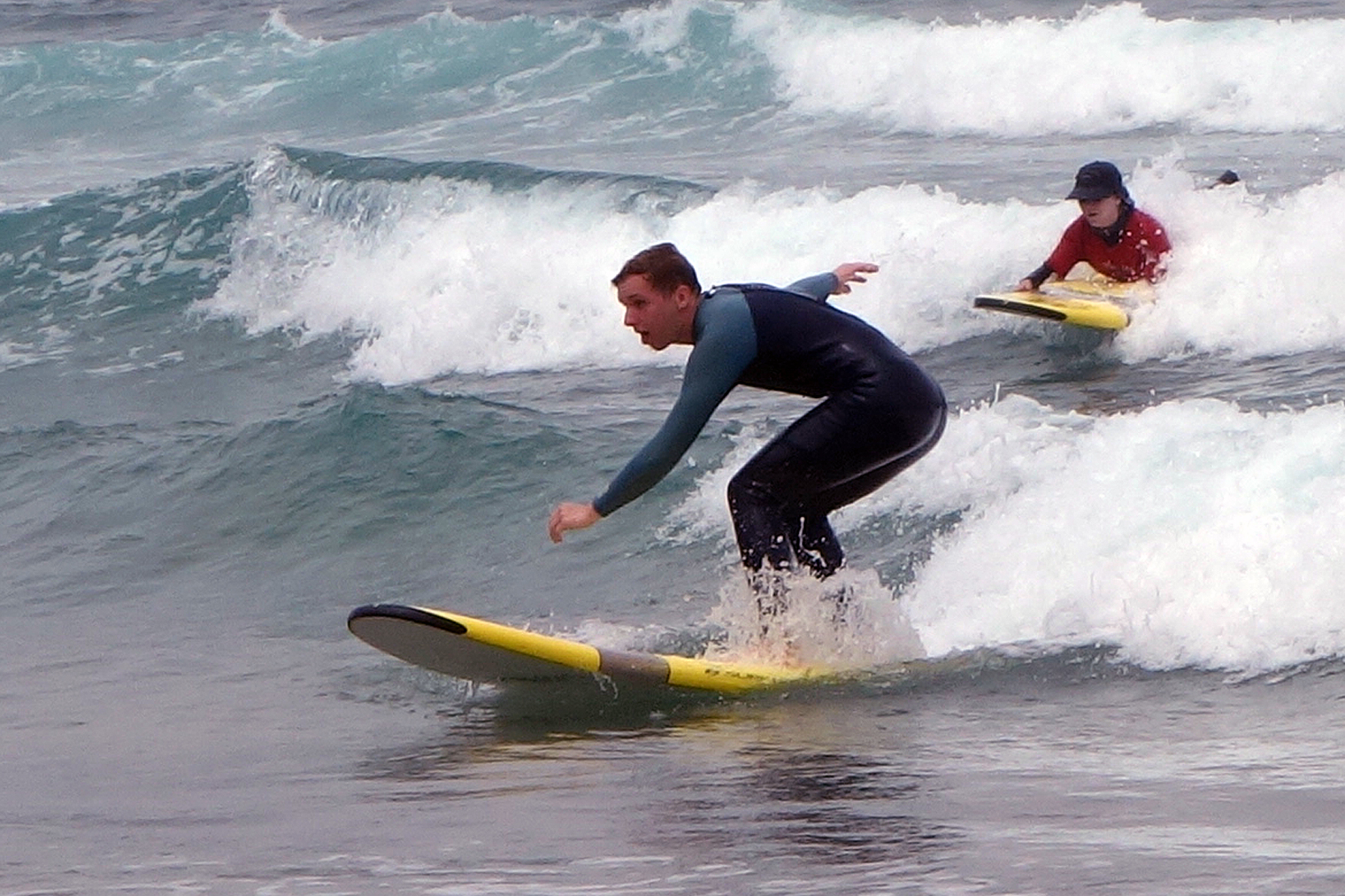 Interns have the opportunity to learn and teach surfing.