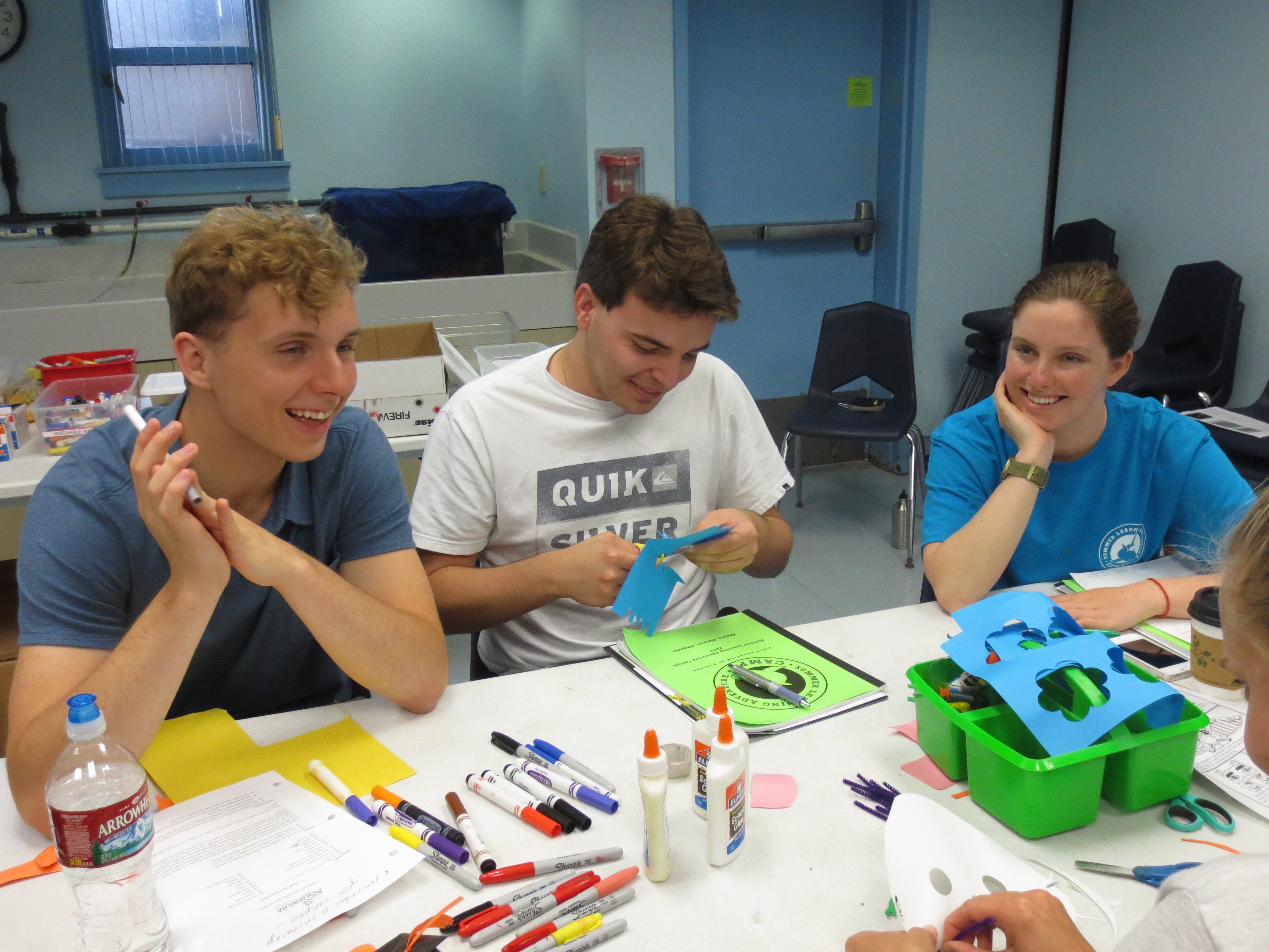 Summer Learning interns get into the crafting spirit as they help Birch Aquarium educators prep for the day's camp lesson.