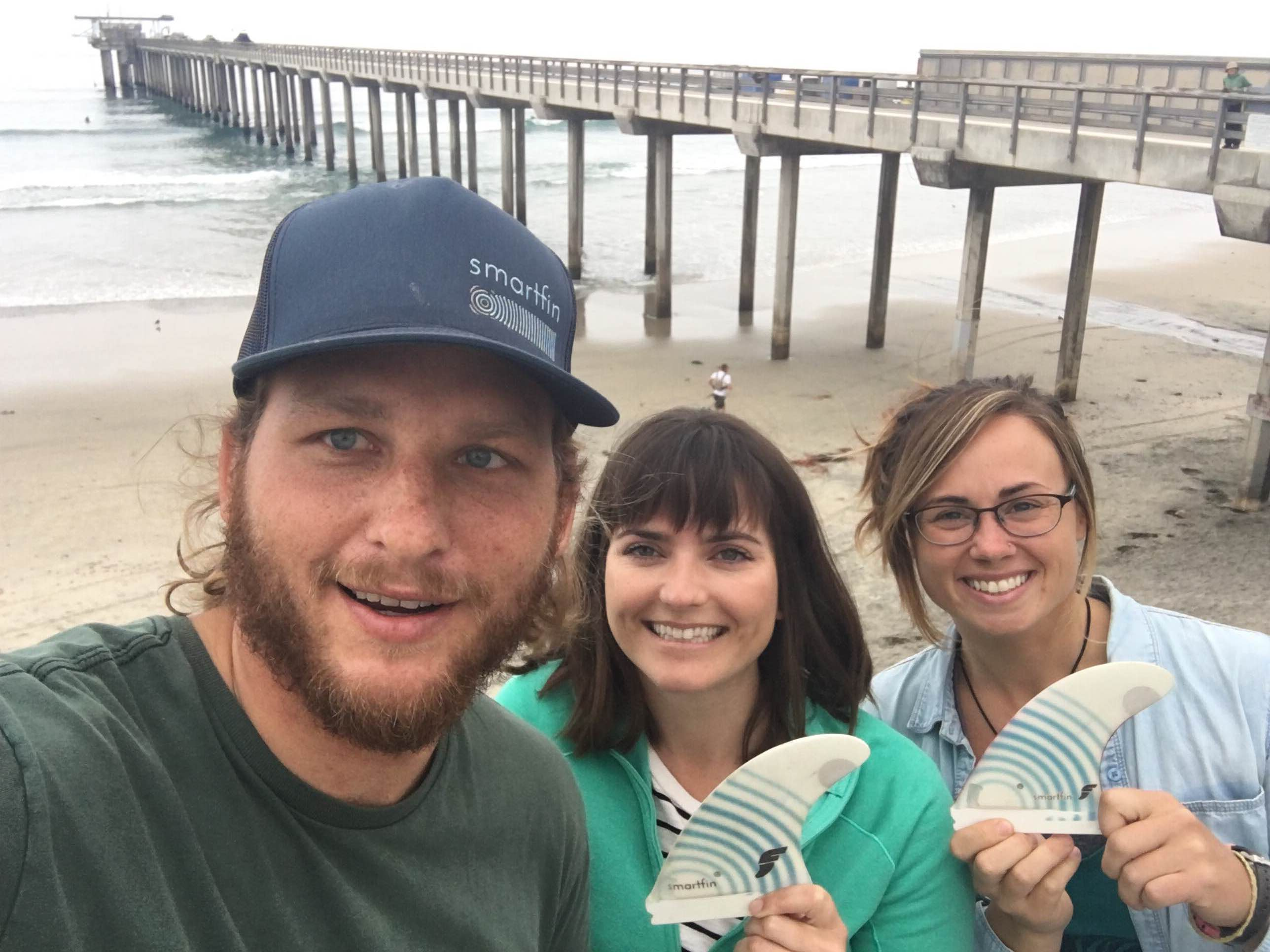 The Smartfin team in front of Scripps Pier. Many Scripps Institution of Oceanography scientists and local San Diegans enjoy surfing by the pier.