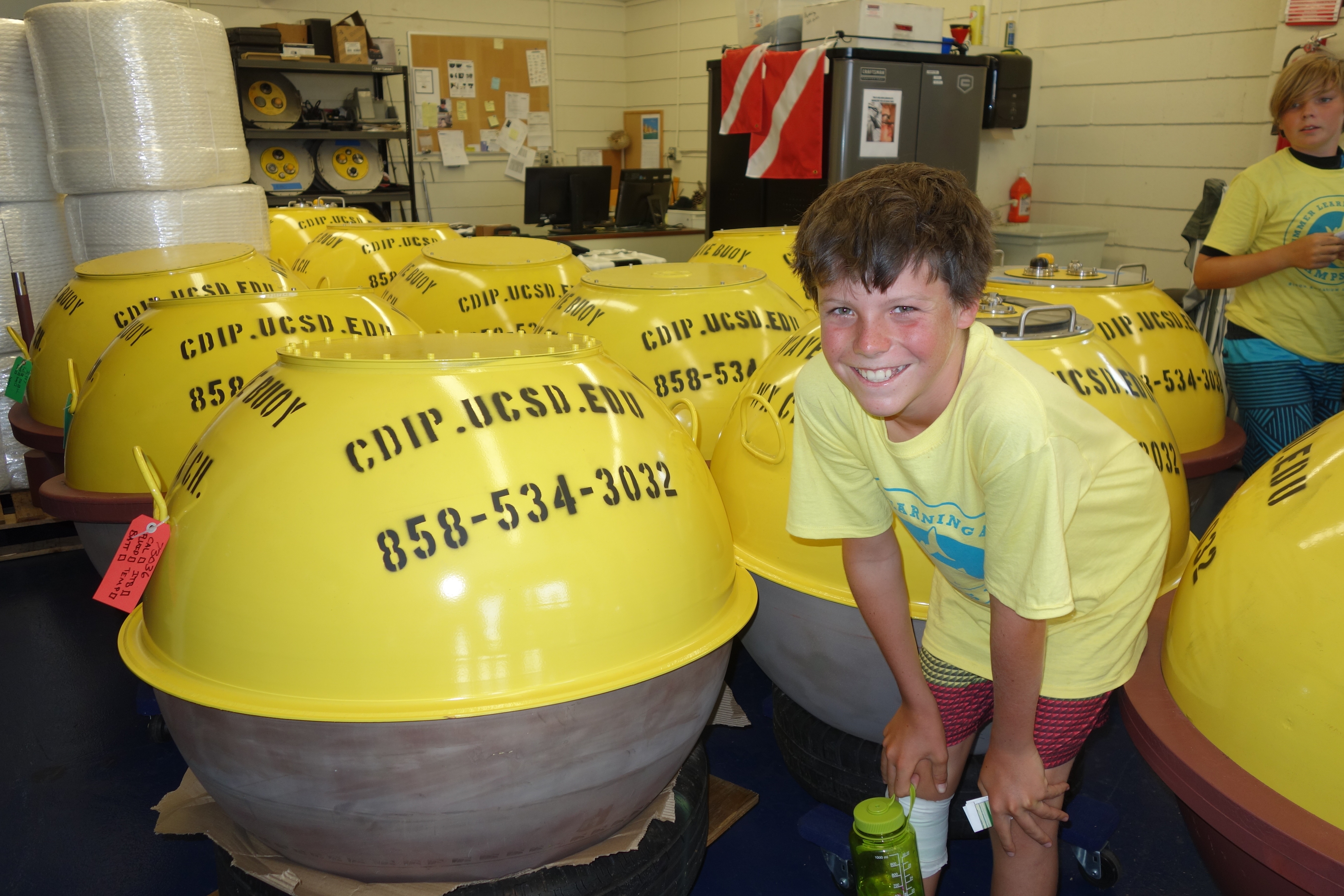 A Summer Learning Adventure camper gets up close and personal with CDIP oceanographic monitoring bouys.